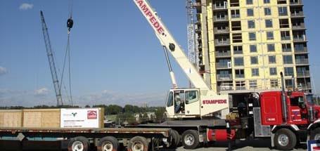 Unloading Construction Picker Truck - Stampede Crane & Rigging